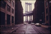 manhattan-bridge-tower-in-brooklyn-framed-through-nearby-buildings